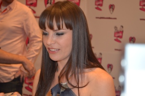Dana DeArmond signing for Girlfriends at the AEE Photo Courtesy of Bill Knight