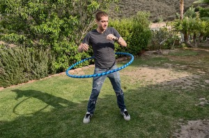 Xander plays with the hoop. Photo by Jeff Koga