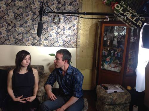 Olalla and Nathan talk among the images within the cabinet.